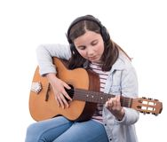 Smiling teenager playing guitar on white background. Smiling teenager playing guitar on the white background Stock Image