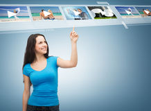 Smiling teenager pointing her finger videos Royalty Free Stock Photos
