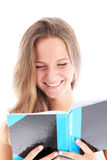 Smiling teenager reading a book Stock Image