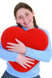 Smiling teenager with red haert Stock Image