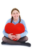 Smiling teenager with red haert Stock Photo
