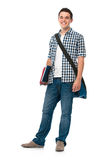 Smiling teenager with a schoolbag. Standing on white background Stock Photography