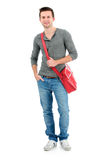 Smiling teenager with a schoolbag Stock Photos
