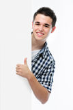 Smiling teenager shows a thumbs up Royalty Free Stock Image