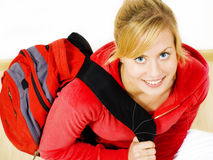 Smiling teenager sitting with backpack Stock Images
