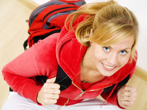 Smiling teenager sitting with backpack Stock Photo