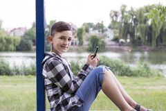 Smiling teenager spending free time in park stock image