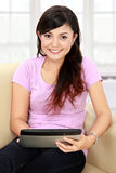 Smiling teenager  with tablet PC Stock Photo