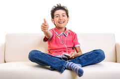 Smiling teenager thumb up smartphone Royalty Free Stock Photography