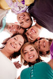 Smiling teenagers in circle. Group of smiling teenagers in circle – view from below Stock Photography