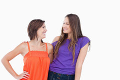 Smiling teenagers friendly looking at each other Stock Photography