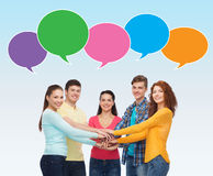 Smiling teenagers with hands on top of each other Stock Photography