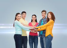 Smiling teenagers with hands on top of each other Royalty Free Stock Image