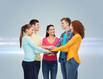 Smiling teenagers with hands on top of each other Royalty Free Stock Photo