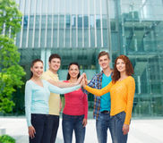 Smiling teenagers making high five Royalty Free Stock Images