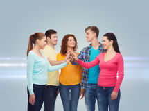 Smiling teenagers making high five Royalty Free Stock Image