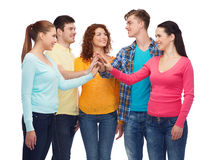 Smiling teenagers making high five Stock Photography
