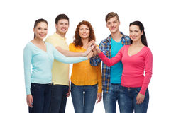 Smiling teenagers making high five Stock Image