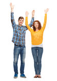 Smiling teenagers with raised hands Royalty Free Stock Image