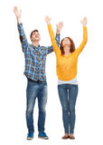Smiling teenagers with raised hands Royalty Free Stock Photo