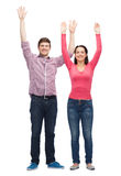 Smiling teenagers with raised hands Royalty Free Stock Photos
