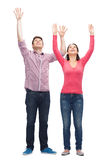 Smiling teenagers with raised hands Royalty Free Stock Photography
