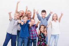 The smiling teenagers showing okay sign on white royalty free stock photos