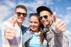 Smiling teenagers showing thumbs up Stock Photos