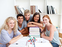 Smiling teenagers studying Science in a library Stock Image