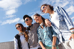 Smiling teenagers in sunglasses hanging outside Royalty Free Stock Photo