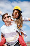 Smiling teenagers in sunglasses having fun outside Stock Photo