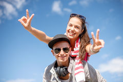 Smiling teenagers in sunglasses having fun outside Stock Images