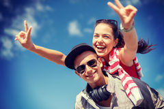 Smiling teenagers in sunglasses having fun outside Stock Photos