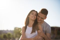 Cheerful young couple embracing outside Stock Images