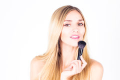 Smiling with teeth woman holding brush for rouge. Happy smiling with teeth woman holding brush for rouge Royalty Free Stock Image