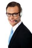 Smiling telemarketing male executive, closeup shot Royalty Free Stock Photography