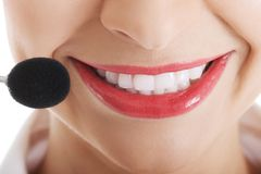 Smiling telemarketing operator with microphone Royalty Free Stock Photos
