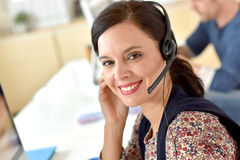 Smiling teleoperator at work Royalty Free Stock Images