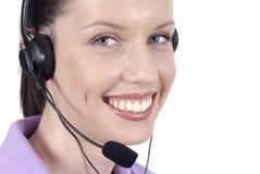 Smiling female telephonist, telephone headset, facing camera, isolated on white background. Attractive female telephonist with headset and happy smile Stock Photos