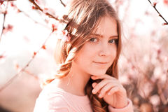 Smiling tenage girl in peach garden Royalty Free Stock Photo