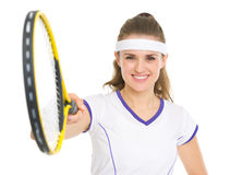 Smiling tennis player pointing racket in camera Royalty Free Stock Images
