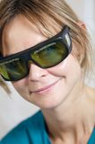 Smiling therapist in protective goggles Stock Images