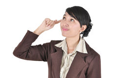 Smiling thinking businesswoman looki Stock Photo