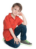 Smiling thoughtful boy royalty free stock photo