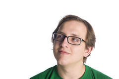 Smiling Thoughtful Man with Glasses on White. Close up Smiling Thoughtful Young Man, Wearing Eyeglasses and Casual Green T-Shirt, Looking to the Upper Left of Stock Image