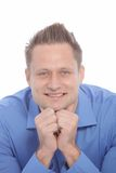Smiling thoughtful man with a modern hairstyle Royalty Free Stock Images