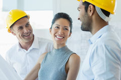 Smiling three architects interacting with each other. In office Royalty Free Stock Image