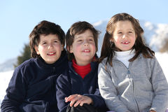 Smiling three brothers in the mountains on snow Royalty Free Stock Photos