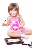 Smiling three year girl drawing Stock Photo