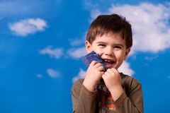 Smiling three year old boy. Portrait on blue sky background Stock Photography